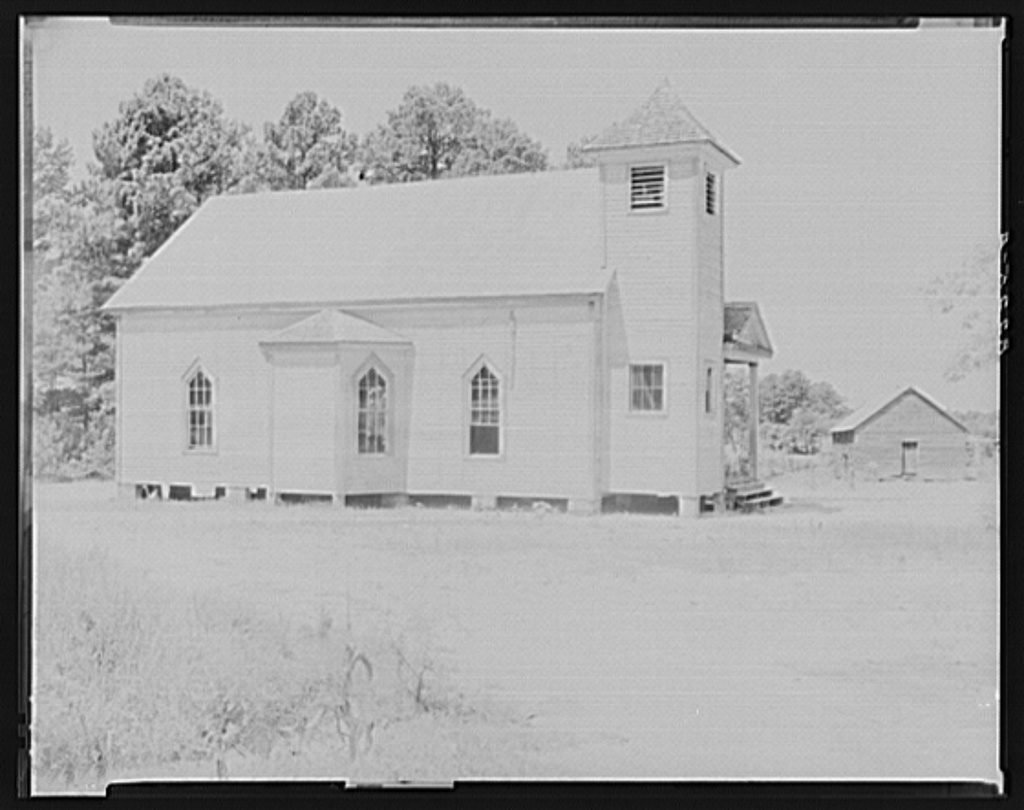 A black-and-white photo of a small country church in Alabama.